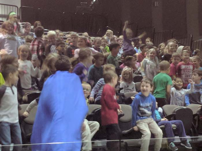 Students excited during the assembly.